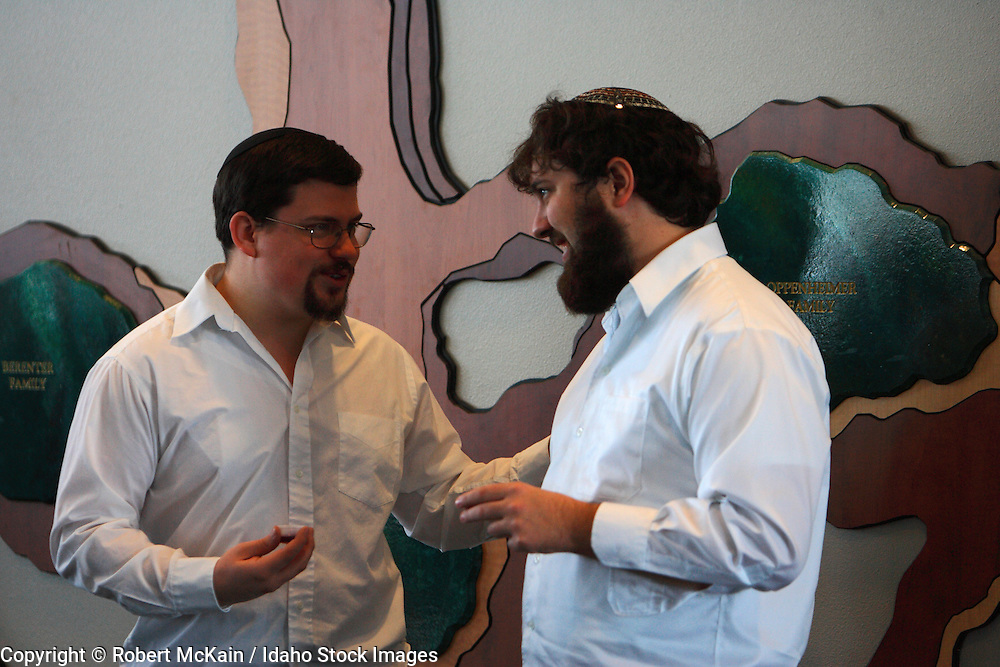 IDAHO. Boise. Jewish men in conversation, wearing yarmulkes. December 2008. #pa080680  MR
