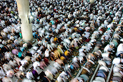 June 15, 2018 - Lhokseumawe, Aceh, Indonesia - Muslims perform Eid al-Fitr prayer at Islamic Center Mosque. Muslims around the world will celebrate the Eid al-Fitr festival after the holy month of Ramadan, where they refrain from sexual activity, eating and drinking from sunrise to sunset. (Credit Image: © Fachrul Reza/NurPhoto via ZUMA Press)
