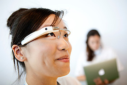 A Google employee wears a pair of the Project Glass, a wearable personal computer device,  during the Google I/O Developer Conference in San Francisco, California.