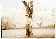 man standing by a tree Jpan ca 1930s