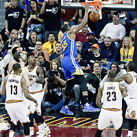 09 June 2017: Golden State Warriors forward Kevin Durant (35) dunks the ball on Cleveland Cavaliers guard Kyrie Irving (2) during the Cleveland Cavaliers 137-11 victory over the Golden State Warriors, in game 4 of the 2017 NBA Finals, at  the Quicken Loans Arena, Cleveland, Ohio, USA.