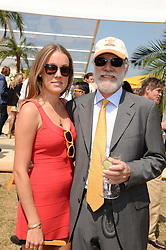 VISCOUNT COWDRAY and his daughter the HON.EMILY PEARSON at the Veuve Clicquot Gold Cup, Cowdray Park, Midhurst, West Sussex on 21st July 2013.