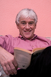 Portrait of an older man reading a book,