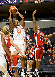 Virginia guard Monica Wright (22) shoots over Richmond guard Brittani Shells (20).  The Virginia Cavaliers women's basketball team faced the Richmond Spiders at the John Paul Jones Arena in Charlottesville, VA on November 18, 2007.