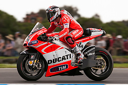 © Licensed to London News Pictures. 20/10/2012. Andrea Dovizioso (ITA) riding for the Ducati Team during the Race day of the round 16 2013 Tissot Australian Moto GP at the  Phillip Island Grand Prix Circuit Victoria, Australia. Photo credit : Asanka Brendon Ratnayake/LNP