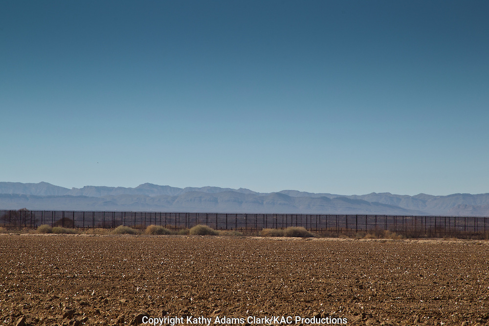 Border fence, or border wall, at Hancock, Texas, separating the United States from Mexico, on the Upper Rio Grande.