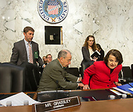 Sen. Chuck Grassley (from left) helps Sen. Dianne Feinstein into her chair before the fourth day of hearings before the Senate Judiciary Committee for Neil Gorsuch to become an Associate Justice of the US Supreme Court in the Hart Senate Office Building in Washington, D.C. on Thursday, Mar. 23, 2017.
