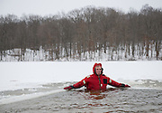 Nate Anderson, who helped clear a portion of Lake Snowden for the Polar Plunge and kept an eye on participants, rests in the icy water during the event on Feb. 8, 2014. Photo by Lauren Pond