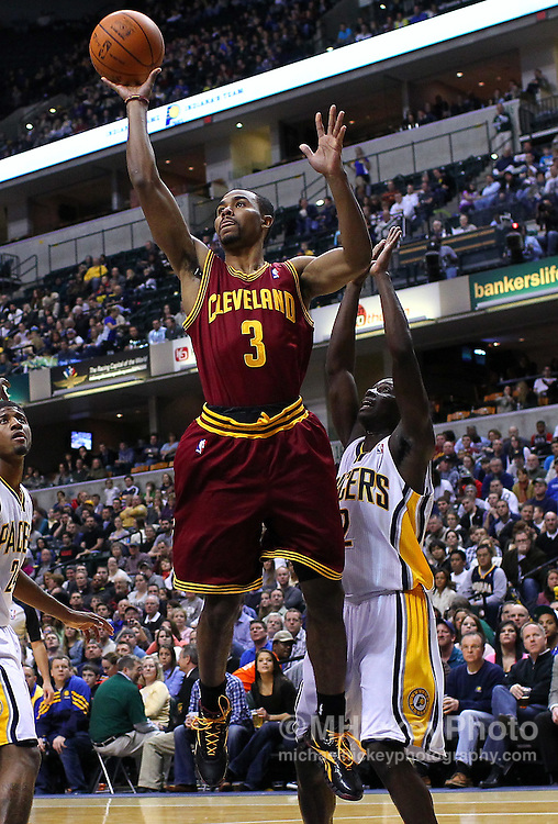 Dec. 30, 2011; Indianapolis, IN, USA; Cleveland Cavaliers point guard Ramon Sessions (3) puts the ball up as Indiana Pacers point guard Darren Collison (2) defends at Bankers Life Fieldshouse. Indiana defeated Cleveland 81-91. Mandatory credit: Michael Hickey-US PRESSWIRE