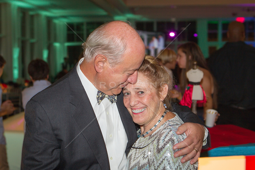 mature couple kissing and being affectionate at a party
