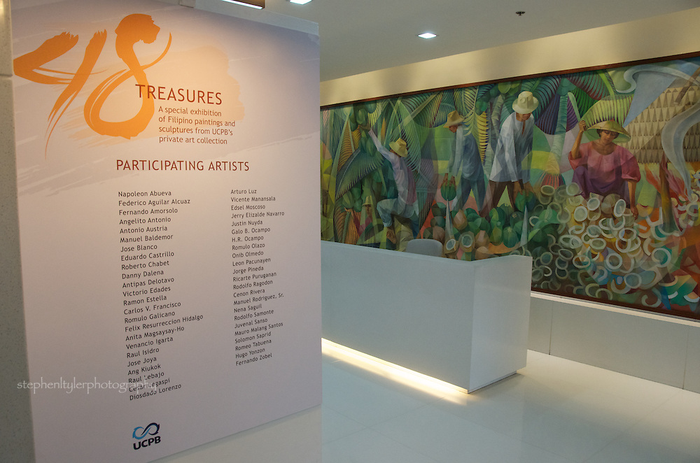 "UCPB corporate headquarters' cultural presentation marking its 48th year anniverary with 48 pieces of Filipino heritage artwork from its collection of legendary and national artists of the Philippines; the permanent mural of ""The Coconut Industry"" by Vincente Manansala (1979) hangs on the wall of the UCPB lobby."