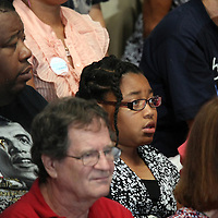 Supporters watch as President Barack Obama delivers his speech during his Grassroots event at the Kissimmee Civic Center in Kissimmee, Florida on Saturday, September 8, 2012. (AP Photo/Alex Menendez)