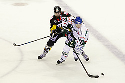 03.10.2014, König Palast, Krefeld, GER, DEL, Krefeld Pinguine vs Augsburger Panther, 7. Runde, im Bild Zweikampf zwischen Joel Perrault #26 (Krefeld Pinguine) und T.J. Trevelyan #24 (Augsburger Panther) (v.l.). Aktion, Action, Querformat // during germans DEL Icehockey League 7th round match between Krefeld Pinguine and Augsburger Panther at the König Palast in Krefeld, Germany on 2014/10/03. EXPA Pictures © 2014, PhotoCredit: EXPA/ Eibner-Pressefoto/ Grimme<br /> <br /> *****ATTENTION - OUT of GER*****