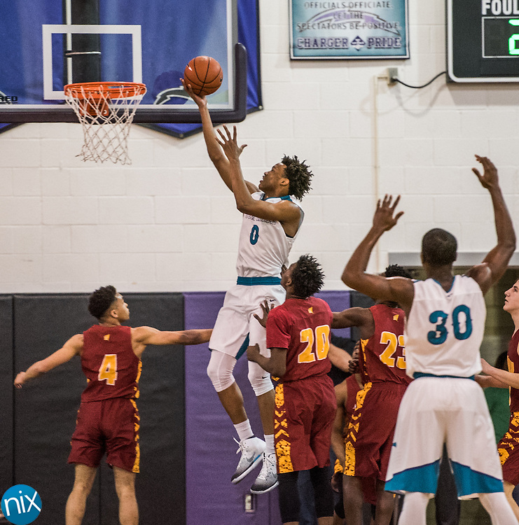 Cox Mill's Wendell Moore (0) puts up a shot against Hickory in the NCHSAA Regional semi-finals Tuesday at Cox Mill High School. Cox Mill won the game 55-52.