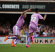 Nick Blackman (Reading striker) celebrating scoring Readings second goal with Anton Ferdinand (Reading defender) during the Sky Bet Championship match between Brentford and Reading at Griffin Park, London, England on 29 August 2015. Photo by Matthew Redman.