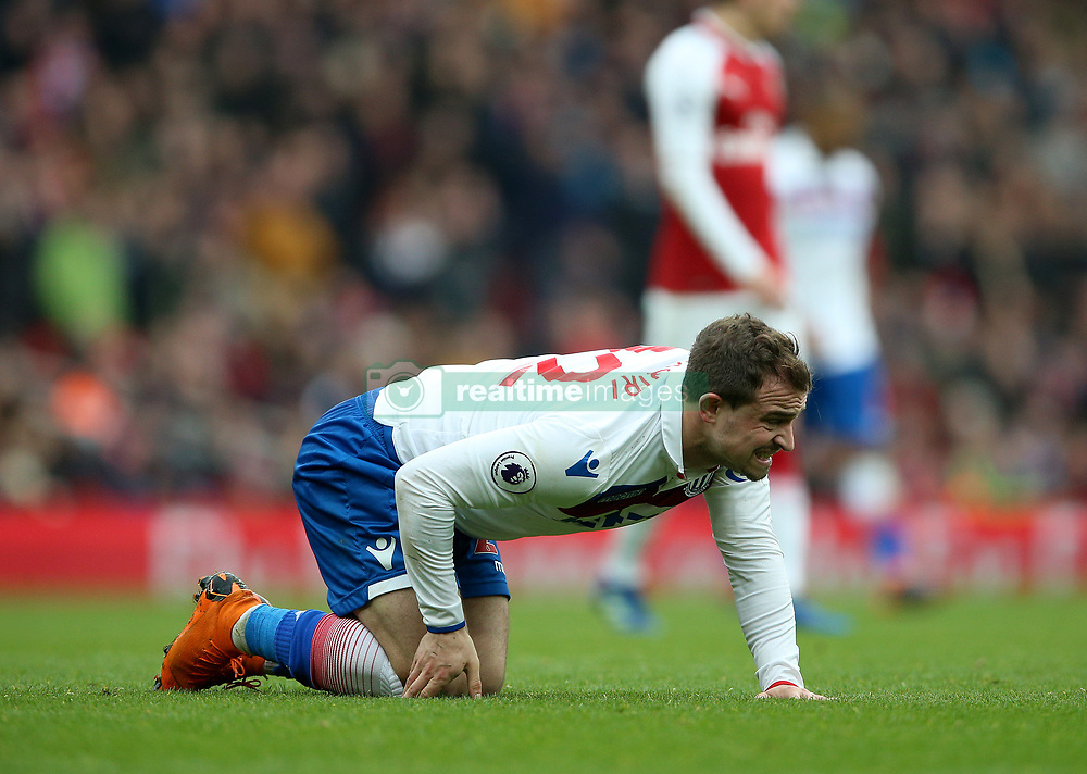 Stoke City's Xherdan Shaqiri holds his knee after a challenge