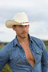 portrait of a sexy cowboy outdoors