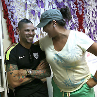 Roxy Santiago of The Center Orlando and professional boxer Orlando Cruz of Puerto Rico smile after Cruz pays his respects to the victims of the Pulse Nightclub shooting on Tuesday, July 12, 2016 in Orlando, Florida. Cruz, who lost four friends in the tragic incident was the first openly gay boxer in the sport and will fight for his fifth time in the Orlando area this Friday.  (Alex Menendez via AP)