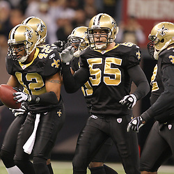 Dec 27, 2009; New Orleans, LA, USA;  New Orleans Saints safety Darren Sharper (42) celebrates after intercepting a pass against the Tampa Bay Buccaneers during the first quarter at the Louisiana Superdome. Mandatory Credit: Derick E. Hingle-US PRESSWIRE..