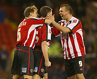 Photo: Aidan Ellis.<br /> Sheffield Utd v Luton Town. Coca Cola Championship.<br /> 01/11/2005.<br /> Sheffield's Neil Shipperly congratulates second goal scorer Chris Morgan on his goal whilst Phil Jagielka joins in the celebrations