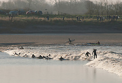 © Licensed to London News Pictures.  21/03/2015. Gloucestershire, UK.  Surfers and kayakers ride the Severn Bore early in the morning at Newnham and Minsterworth.  The alignment of the sun and moon creates high tides.  Photo credit : Simon Chapman/LNP