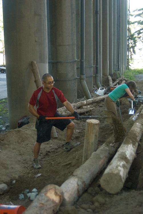 Trailbuilders Jason Hotai and Susan Clark collaborating at the Colonnade Mountain Bike Park in Seattle, WA