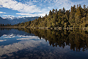 Lake Matheson reflection, with a view of Mt. Cook and Tasman in the distance.
