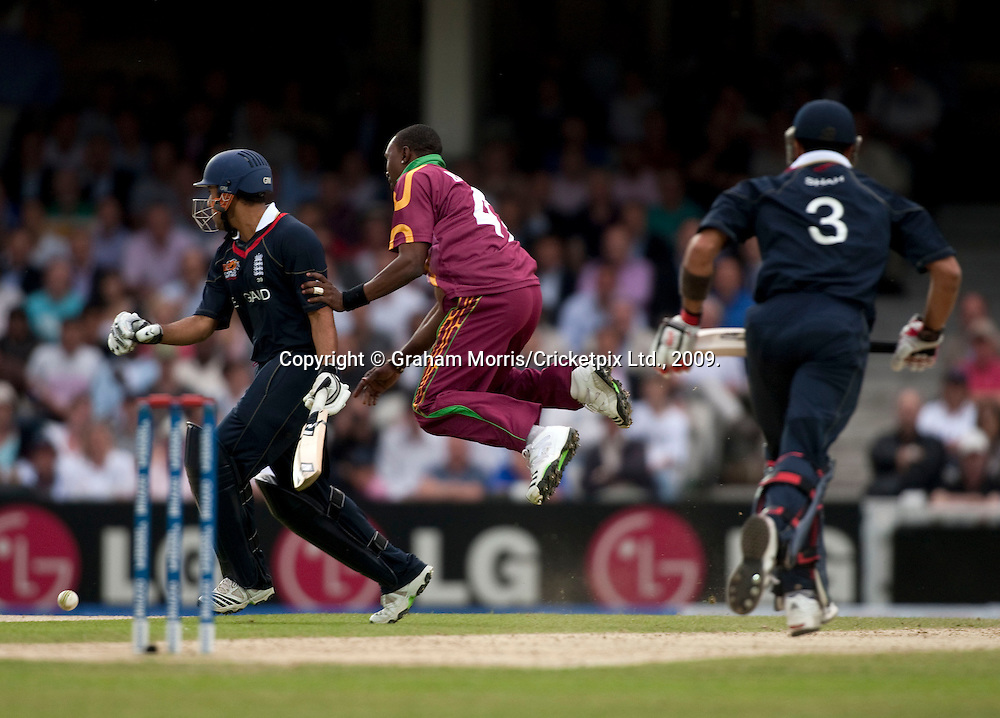 Ravi Bopara runs past leaping bowler Jerome Taylor during the ICC World Twenty20 Cup match between West Indies and England at The Oval. Photo © Graham Morris (Tel: +44(0)20 8969 4192 Email: sales@cricketpix.com)