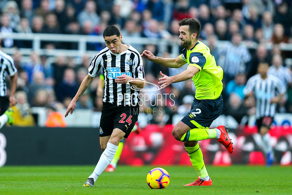 Miguel Almiron (#24) of Newcastle United bursts away from Tommy Smith (#2) of Huddersfield Town during the Premier League match between Newcastle United and Huddersfield Town at St. James's Park, Newcastle, England on 23 February 2019.