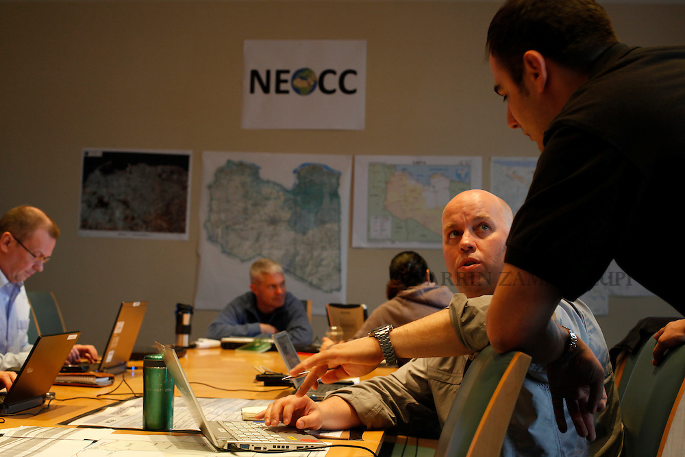 Members of the Non-Combatant Evacuation Operation Coordination Cell (NEOCC) comprising military representatives from the UK, France, Germany, Italy, the Netherlands, Sweden, the USA, Malta, Canada, Australia, Ireland and Hungary work in an office set up at the British High Commission at Ta' Xbiex in Valletta's Marsamxett Harbour March 4, 2011.  Over the last eight days they have managed to organise the evacuation of around 4,000 people from Libya. The NEOCC members work together with their respective Foreign and Defence ministries to use both military and civilian assets to get people out of the North African country. Picture taken March 4, 2011..REUTERS/Darrin Zammit Lupi (MALTA)