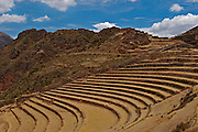 Ruins of the archeological place of Pisac where is posible see how the Incas change the shape of the mountains to use them as place to cultivate their  plants for food..Inca farms in the highlands were built using terraces constructed from stone with deep, soil filled pits for the crops.In each step they could grow up different kinds of plants due to the differents temperatures that they provide. Located in the region of Cusco in Peru.