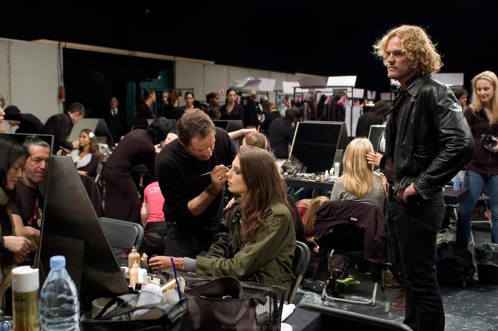 Peter Dundas, Ungaro's designer, overlooking make-up work, backstage before the fashion show