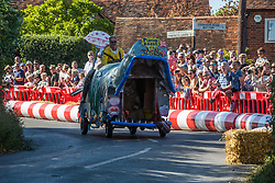 Cookham Dean, UK. 1 September, 2019. A custom-built kart in the form of a whale competes in the Cookham Dean Gravity Grand Prix in aid of the Thames Valley and Chiltern Air Ambulance.