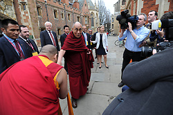 The Dalai Lama visits Cambridge to attend a press conference hosted by Global Scholars Symposium at the Divinity School of St Johns College. He is pictured being greeted by a Buddhist monk before the conference, Cambridge, UK, Friday April 19,  2013, Photo by: Matthew Power / i-Images