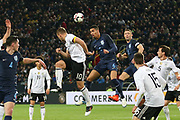 Chris Smalling of England heads the ball clear battling with Lukas Podolski of Germany during the International Friendly match between Germany and England at Signal Iduna Park, Dortmund, Germany on 22 March 2017. Photo by Phil Duncan.