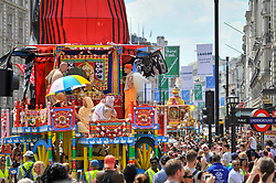 """© Licensed to London News Pictures. 18/06/2017. London, UK. Devotees celebrate the annual Rathayatra festival (""""cart festival""""), in central London.  Hare Krishna followers towed three huge decorated carts from Hyde Park corner to Trafalgar Square, singing and dancing all the way.  Photo credit : Stephen Chung/LNP"""