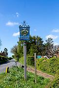 Village sign against blue sky with copy space, Shottisham, Suffolk, England, UK