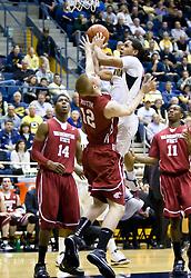 February 13, 2010; Berkeley, CA, USA;  Washington State Cougars forward Brock Motum (12) fouls California Golden Bears guard Jorge Gutierrez (2) during the first half at the Haas Pavilion. California defeated Washington State 86-70.