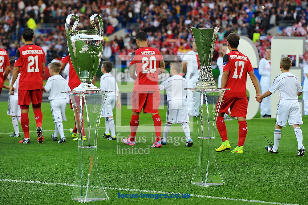 Champions League and Europa League trophies on display as the teams take the field pictured ahead of the European Super Cup match at the Cardiff City Stadium, Cardiff<br /> Picture by Ian Wadkins/Focus Images Ltd +44 7877 568959<br /> 12/08/2014
