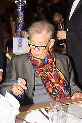 Old Town Hall, Stratford, London - 28 November 2015. Singers Marc Almond, Ronan Parke, Heather Peace and Asifa Lahore headline the Peter Tatchell Foundation's inaugural Equality Ball, a fundraiser for the foundation's LGBTI and human rights work, with guest of honour Sir Ian McKellen  joined by Michael Cashman. PICTURED:  Sir Ian McKellen autographs a musical score from Lord of Tthe Rings, to be raffled.  //// FOR LICENCING CONTACT: paul@pauldaveycreative.co.uk TEL:+44 (0) 7966 016 296 or +44 (0) 20 8969 6875. ©2015 Paul R Davey. All rights reserved.