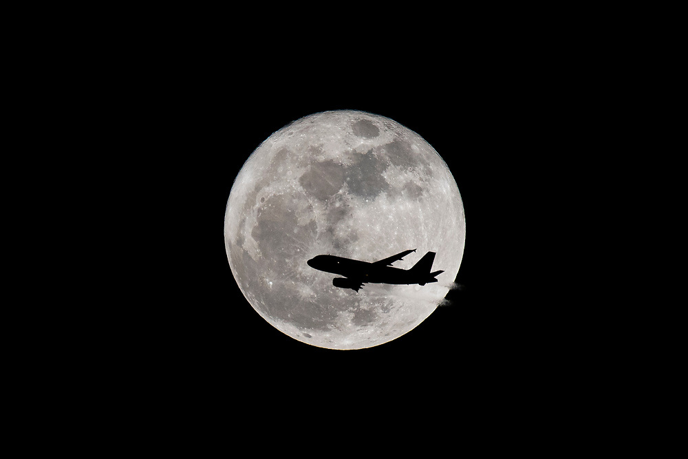 Dec. 3, 2017: A Spirit Airlines A319 departs Fort Lauderdale / Hollywood International Airport with the rising Super Moon.