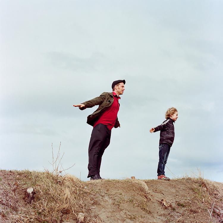 ANCHORAGE, ALASKA - 2012: Musican Jonathan J. Bower and his son Sam.