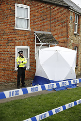 © Licensed to London News Pictures. 15/03/2017. Faringdon, UK. Police attend the scene after a child was found dead. Thames Valley police said a woman has been arrested on suspicion of murder after they found the body of a child at a property at Bromsgrove Cottages in Faringdon  yesterday lunchime.   Photo credit: Peter Macdiarmid/LNP