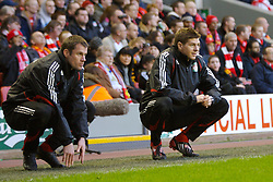 LIVERPOOL, ENGLAND - Saturday, January 26, 2008: Liverpool's super-star substitutes Jamie Carragher and captain Steven Gerrard MBE watch from the sidelines during the FA Cup 4th Round match against Havant and Waterlooville at Anfield. (Photo by David Rawcliffe/Propaganda)