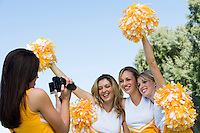 Cheerleader Videotaping Teammates
