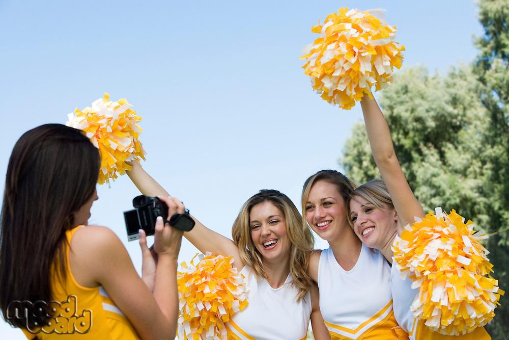 Cheerleader Videotaping Teammates
