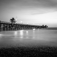 San Clemente pier at sunset black and white photo. San Clemente California is a popular beach city in Orange County in the United States of America. Copyright ⓒ 2017 Paul Velgos with all rights reserved.