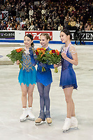 KELOWNA, BC - OCTOBER 26: Ladies silver medalist, Rika Kihira of Japan, gold medalist, Alexandra Trusova of Russia and bronze medalist, Young You of Korea stand on the ice during medal ceremonies of Skate Canada International held at Prospera Place on October 26, 2019 in Kelowna, Canada. (Photo by Marissa Baecker/Shoot the Breeze)