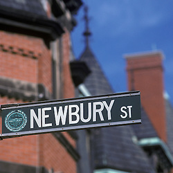 Newbury Street sign and brownstone buildings, Boston, MA.