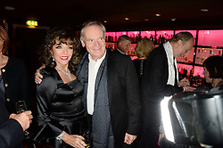 JOAN COLLINS and LORD ARCHER at a party to celebrate the publication of 'Passion for Life' by Joan Collins held at No41 The Westbury Hotel, Mayfair, London on21st October 2013.
